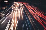 Night car traffic. Motion blur car viewed from the road bridge in big modern city. - 220536192