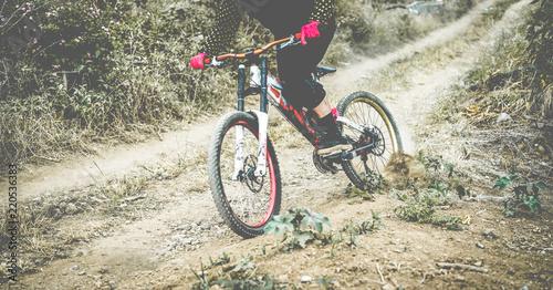 Enduro athlete training outdoor with bike