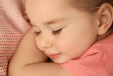 Cute little girl sleeping in bed at home, closeup - 220536706