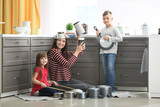 Family playing with kitchenware as musical band at home - 220536973