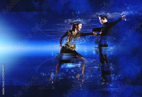 Pair of dancers dancing ballroom