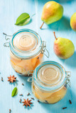 Sweet and tasty pickled pears in the jar - 220553118