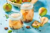 Sweet and tasty pickled pears on blue table - 220553129