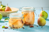 Natural and juicy pickled pears on blue table - 220553130