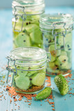 Fresh ingredients for pickled cucumber on blue table - 220553176
