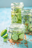 Fresh ingredients for canned cucumber on blue table - 220553186