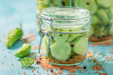 Homemade and tasty pickled cucumber in the jar - 220553188