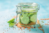 Natural and healthy pickled cucumber on blue table - 220553189