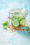 Homemade and tasty pickled cucumber on blue table - 220553194