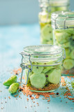 Homemade and tasty canned cucumber in the jar - 220553195