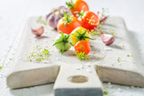Fresh ingredients for pickled red tomatoes in summer - 220553346