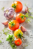 Preparation for fresh pickled red tomatoes in the jar - 220553347