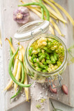 Natural canned green and yellow beans in the jar - 220553368