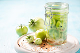 Fresh ingredients for pickled green tomatoes in the jar - 220553503
