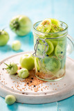 Preparation for fresh pickled green tomatoes in the jar - 220553517