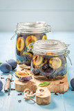Preparation for fresh canned purple plums in the jar - 220553535