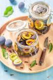 Preparation for fresh pickled purple plums in the jar - 220553571