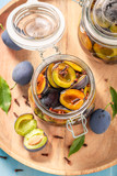 Preparation for fresh canned purple plums in the jar - 220553588