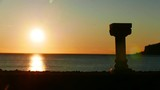 Greek column on shore and scenic sunset over sea surface, Greece. Time lapse - 220558160