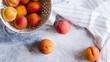 Fresh peaches fruits  on textured stone background - 220569574