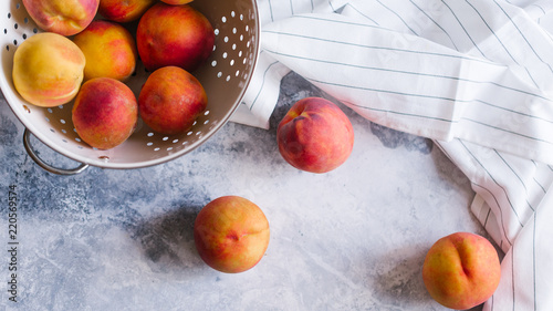 Fresh peaches fruits  on textured stone background - 220569574