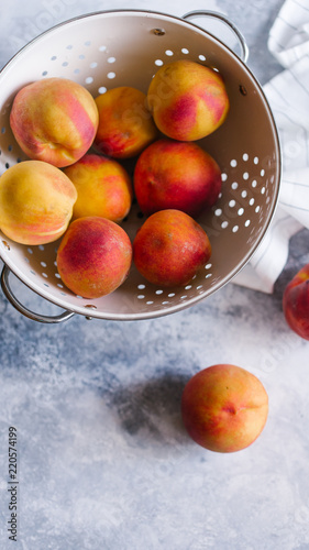 Fresh peaches fruits  on textured stone background - 220574199