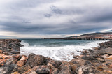 Beach landscape and rocks with cloudy sky - 220584373
