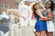 Leinwanddruck Bild - Two happy young women flirting with the camera