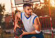 Portrait of young basketball player outdoor.