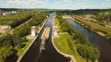 Sluice Gates on the River. Aerial view barge, ship in the river gateway. River sluice construction, water river gateway. Shipping channel. 4K, flying video, aerial footage - 220619173