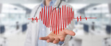 Doctor holding heartbeat digital interface 3D rendering - 220622755