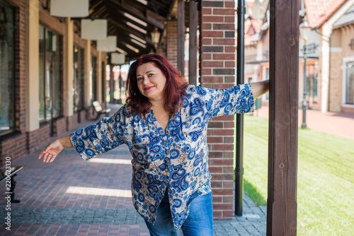 Portrait of attractive plus size mature woman in casual style walk ...