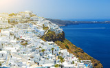 Oia town on Santorini island, Greece. Traditional and famous houses and churches with blue domes over the Caldera, Aegean sea - 220637135
