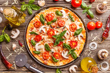 Flat lay with Italian pizza