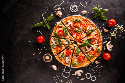 Tasty pizza with cherries, onions and mushrooms on a black background - 220639944