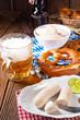 Leinwandbild Motiv delicious bavarian oktoberfest white sausage with sweet mustard