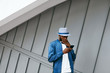 Handsome Black Man In Fashion Clothes With Phone On Street