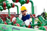 Engineer, working with pipeline controls inside oil and gas refinery - 220652591
