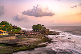 Sunset at Tanah Lot Temple on Sea in Bali Island - 220655566