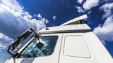 Clouds reflected in the Windows of the truck - 220667730
