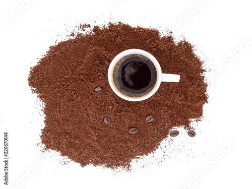 Strong, black espresso in a white cup, with freshly ground coffee and beans. Isolated on white background. - 220670144