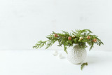 Vintage Christmas decoration made from natural evergreen twigs. Copy space - 220670908