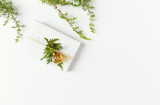 Christmas present decorated with evergreen twigs on white background. Flatlay. Copy space - 220670919