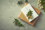Christmas presents with natural evergreen twigs on gray background. Flatlay. Copy space - 220670920
