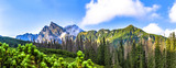 Polish Tatra mountains summer landscape with blue sky and white clouds. Panoramic HDR montage
