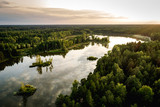 Aerial photo of the lake in the forests in sunset. Lake with small islands - 220679368