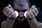 Portrait of handcuffed criminal man imprisoned. - 220688961