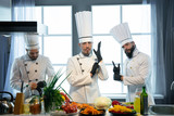 The cook wears gloves before starting work - 220689510