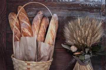 Homemade pastries with spikelets on a wooden background. The concept of still life.
