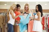 Women choosing dress - 220692139